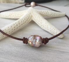 A personal favorite from my Etsy shop https://www.etsy.com/listing/274247182/freshwater-pearl-choker-fireball-pearls