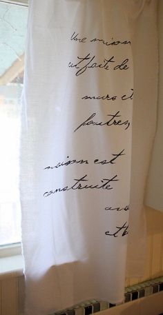 I'm going to do this using 6' x 9' painters drop clothes.  I'm writing quotes from my son's favorite book, splitting each cloth (3) down the middle, hemming the cut edge and hang!  Hope it works!