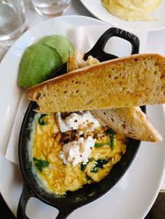 broken eggs with ricotta, spinach and pine nuts.