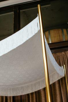 Chuppah Studio's Jolie Vie silk chuppah canopy with gold poles. Photo by Tory Williams Photography at Brooklyn Winery