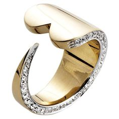 """A+sleek+and+stylized+heart+wraps+a+glittering+row+of+diamonds+around+your+finger.+Pianegonda+ring+in+18kt/14kt+gold.+Approx.+width:+5/8"""".+Size:+7.+"""