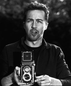 Edward Norton winds a Rolleiflex.  Beautiful machines which reminds me I need to get mine fixed.
