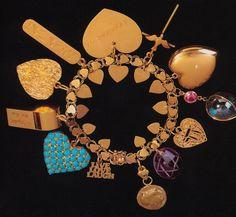 Elizabeth Taylor's gold charm bracelet with 12 charms.
