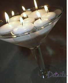 floating candles in martini glass centerpiece
