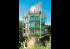 """""""The Heliotrope"""" designed by Rolf Disch is a house in Vauban, Freiburg, Germany that runs on solar power and generates more power than it uses. (photo by Rolf Disch SolarArchitektur, © Words cannot describe how awesome this is. Unusual Buildings, Interesting Buildings, Amazing Buildings, Architecture Unique, Interior Architecture, Sustainable Architecture, Pavilion Architecture, Residential Architecture, Sustainable City"""
