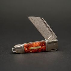 """Combining the natural beauty of Red Maple Burl with the mesmerizing allure of Damascus steel the Andre de Villiers Mini Butcher is as """"wood"""" as it gets. Available at the link in our bio!   #andredevilliers #andredevilliersknives #andredevilliersbutcher #knifenuts #knivesdaily #knifelife #knifeclub #knifelife #knifecommunity #knifecollection #knifenut #utilityknife #knife #knives #usnstagram #usnfollow #pocketknife #knifestagram #customknife #customknives #grailknife #grailknives"""