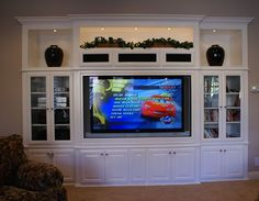 Image result for recessed built in cabinets around 75 inch TV