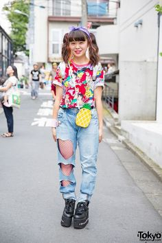 August 2015: Gocchi  She is wearing a Ariel t-shirt from Tokyo Disneyland with remake heart cutout jeans (with red hearts on the back), fishnet stockings, and WEGO platforms (deocrated with stickers). Her accessories – some of which are from Spinns – include a pineapple phone case, a purple bandana, and a holographic WEGO backpack.