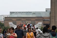 People cross the Millennium Footbridge across the River Thames with the Tate Modern gallery in the background in London on August 4, 2019 after it was put on lock down and evacuated after an incident involving a child falling from height and being airlifted to hospital.  (Photo by Daniel SORABJI / AFP) (Photo credit should read DANIEL SORABJI/AFP/Getty Images)