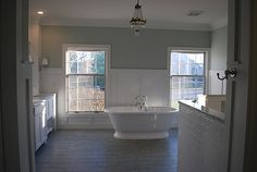 something is not quite right with this bathroom... but I love the tiles and cool gray tones...