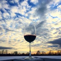 The colors of the sunset reflected in a glass of chianti classico.  winegram.it share your wine