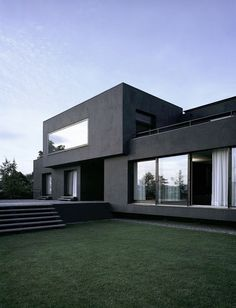 Clean lined, flat faced, greyscale house.