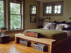 Vintage Industrial    For the master bedroom, a chunky cedar bed offers rough-around-the-edges appeal to a darker palette of olives greens by eddie