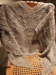 Ravelry: Winterwind's Venice Shawl.  Love the detail, but would select a different color yarn.