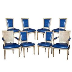 Blue leather dining chairs from France. These would look great in my red dining room!