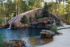 Rock water slide into pool