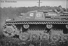 A StuG 3 in action with the name 'Blondine' painted on the side.