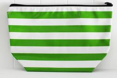 "CS-Stripe Green.  Our ""Original"" Cosmetic Bags! Long before the Ellie Cosmetic Bags, these were our very first cosmetic bags. Available in 3 sizes and all feature a zipper and lined with a coordinating Oilcloth pattern of our choice. Never Stains, just wipe clean when your makeup spills or the chocolate bar melts!  Monogramming available.   #sarahjanesoilcloth #love #madeintheusa www.simplysjo.com"