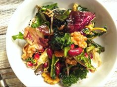 Health-In-A-Bowl: an antioxidant rich blend of sliced chard, spinach, kale, radicchio & escarole w/ pom seeds, raw walnuts, sprouted mung beans, kidney beans, extra virgin olive oil, balsamic, mix of yellow and dijon mustards