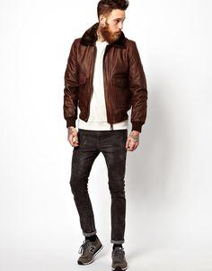 Brown leather men's jacket, white tee, skinnies.