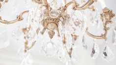 Love this little chandelier & the matte gold finish