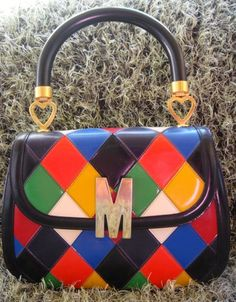 7f5f8353a0 Moschino ~ Any Moschino bag from the would be a great find, especially if  it has the
