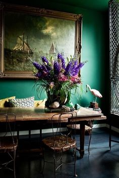 I am immediately drawn to the floral arrangement.  Next, I see the painting, and then the chair.
