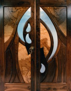 """Friede's Friend"" by Fine Woodworks Custom Doors. This interior set of doors is solid walnut with olive burl panels. Made of Solid Walnut and Olive Burl. Visit our website for additional photos and pricing."