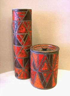 Mid-Century Italy gave us this fantastic pair of Aldo Londi for Bitossi vessels - a cylindrical vase with a grey glazed interior and a...
