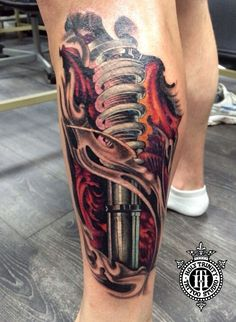 Fantastic biomechanical leg piece tattooed in the studio by Cosmo