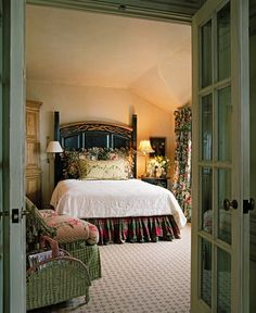 Love the tall headboard and the green french doors leading into the room especially...very English country (www.lindafloyd.com)