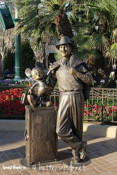 """""""Storyteller"""" Statue on Buena Vista Street in DCA   Not far away from the Carthay Circle Theater is the """"Storyteller"""" statue of Walt & Mickey which represents Walt during the studio years. The statue stands on the ground & is life size. Walk right up to him & take your picture w/ him   22 July 2012"""