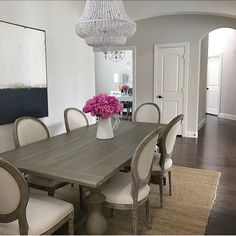Dining room inspo, classic gray Benjamin Moore paint, restoration hardware dining table 17th century monastery grey acacia, Louis chairs, jute rug, white chandelier, abstract art, pink peonies, interior design, neutral decor, transitional dining room  (@thedecordiet) on Instagram