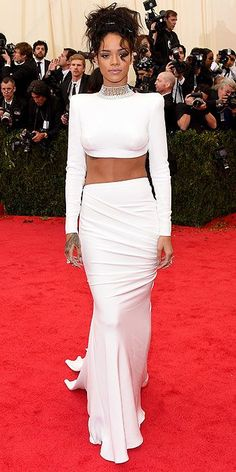 2014 Met Gala: Rihanna wore a Stella McCartney ensemble that consisted of a white long sleeve backless crop top with a high neckline and the matching white long skirt. I adore Rihanna's red carpet outfits! I can't wait to see what she wears to 2015 Met Gala!