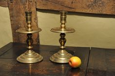 A LARGE PAIR OF MID 17TH CENTURY BRASS CANDLESTICKS. DUTCH. CIRCA 1650.