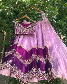 Beautiful Silk and raw silk Lehenga-Choli with hand work embellishments. Paired with net dupatta. Indian Fashion Dresses, Indian Bridal Outfits, Indian Gowns Dresses, Dress Indian Style, Indian Designer Outfits, Half Saree Designs, Choli Designs, Lehenga Designs, Half Saree Lehenga