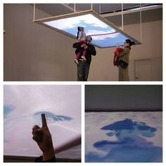 "(720×720)  ""Cloud Pink"" is an interactive installation that allows the public to touch and manipulate clouds. The immersive piece features a fabric screen that invites visitors to poke the material from below, thereby causing a visual reaction in the projected simulation of wafting pink clouds."