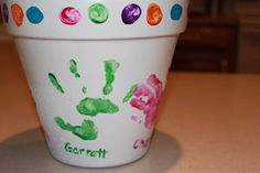 Great Mother's Day gift for the kids to give Grandmom... Flower pot with their handprints! Put a pretty plant/flowers inside & you're good to go!!