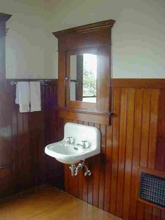 Original bathroom in the 1901 Zanone House in Eureka, Calif. Redwood bead board and wall-hung sink.