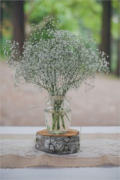 baby breath centerpieces for a rustic wedding