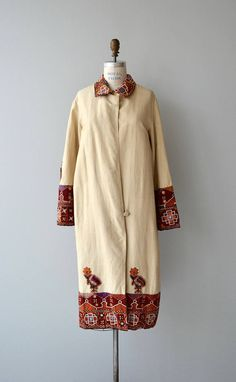 Antique 1920s french vanilla woven silk coat from Morocco with richly toned embroidery, mirror & applique work traveling up the hem, very wide at the sleeves and repeated at the collar. Two closures. --- M E A S U R E M E N T S ---  fits like: one size fits most shoulder: 15.5 waist: free hip: free sleeve: 24 length: 45 brand/maker: n/a condition: very good, discoloration on one button  ★ layaway is available for this item  ➸ More vintage coats http://www.etsy.com/...