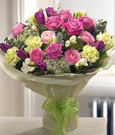 Spring Style - Delicately fragrant and stunning in design, this aqua pack bouquet is a spring fresh, sophisticated arrangement featuring Roses, Tulips, Carnations, Freesias and Ranunculas.