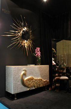 Camilia Cabinet, Guilt Mirror, Jezebel Screen and a soft throw composing our stunning Classic corner at the booth. black and gold furniture, gold detail, black furniture