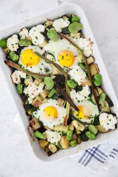 Baked Eggs with Seasonal Veggies includes eggs, zucchini, beans, potatoes, mushrooms, and Ricotta cheese to produce a zesty meal for all to enjoy.