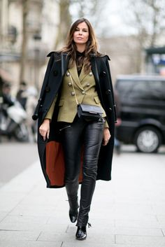 A military blazer, black coat, leather pants, and black boots.