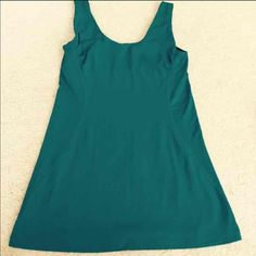 Sexy Gap Fit Breathe Ruched Side Yoga Tank Top Pretty deep ocean blue turquoise color!! Has built in mesh lining bra and side rouge near bust area .. Can also fit a small GAP Tops Tank Tops