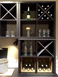 KALLAX with NORNÄS wine inserts at KALLAX area in IKEA Amsterdam. Black brown combined with gray in a rustic atmosphere. #JanineJacobs