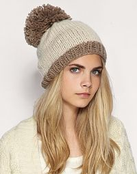 Simply sweet ivory and taupe winter hat worn by Model Cara Delevingne. 289066f5cc5