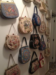 Needlepoint vintage bag collection at the hall atop of the stairs