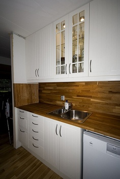 A cabinet with glass doors and...  Pinned from PinTo for iPad 